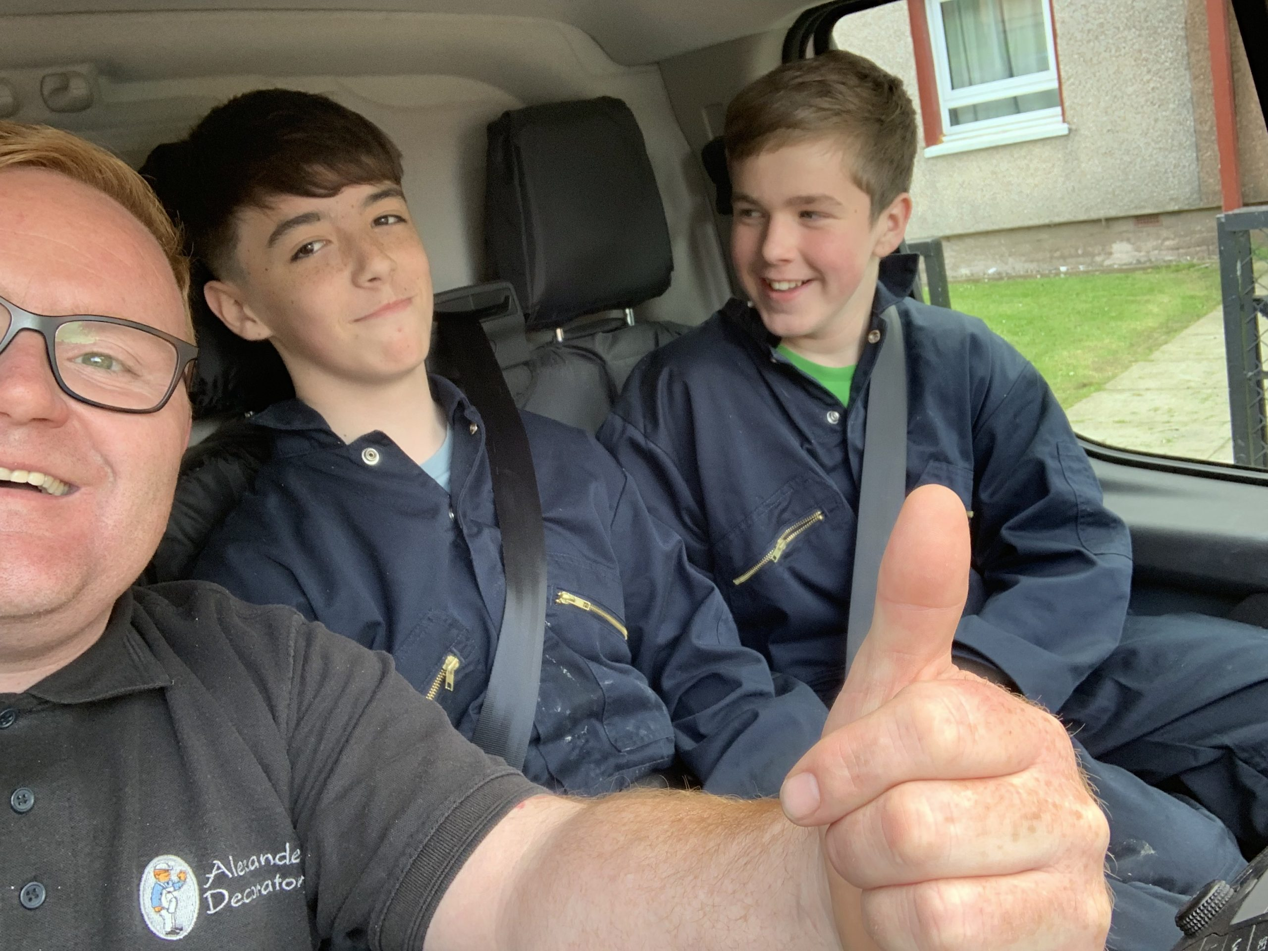 John and 2 young apprentices in the van