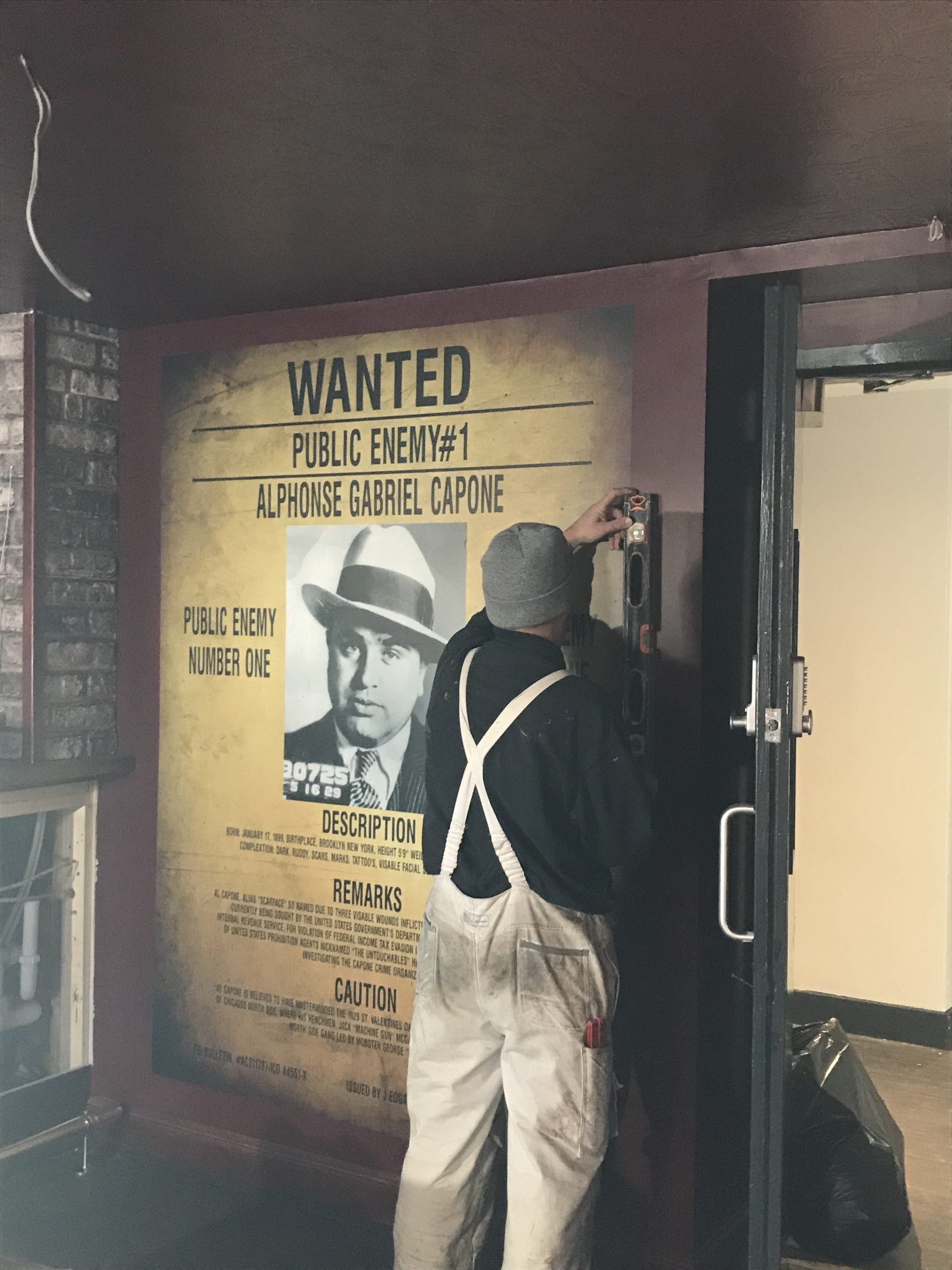 Public enemy wanted poster on the wall
